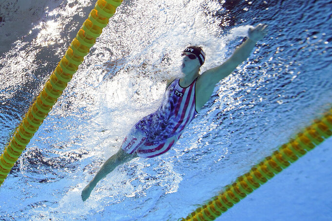 Katie Ledecky, of the United States, swims to the gold medal in the women's 800-meter freestyle final at the 2020 Summer Olympics, Saturday, July 31, 2021, in Tokyo, Japan. (AP Photo/Jeff Roberson)