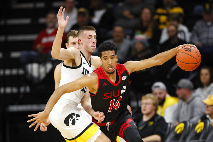 SIU-Edwardsville guard Zeke Moore drives around Iowa guard Joe Wieskamp, left, during the first half of an NCAA college basketball game, Friday, Nov. 8, 2019, in Iowa City, Iowa.(AP Photo/Charlie Neibergall)