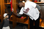 FILE - In this Jan. 19, 2018, file photo, Minnesota Twins' Michael Pineda greets a young fan during the baseball team's TwinsFest in Minneapolis. The Twins signed Michael Pineda more than a year before he'll be cleared to pitch, aiming for what could be a bargain for the rotation this season if the big right-hander bounces back from elbow surgery.(AP Photo/Hannah Foslien, File)