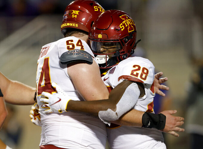 Iowa State running back Breece Hall (28) is congratulated by offensive lineman Jarrod Hufford (54) after scoring against Kansas State during the second quarter of an NCAA football game on Saturday, Oct. 16, 2021, in Manhattan, Kan. (AP Photo/Colin E. Braley)