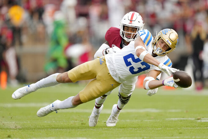 UCLA wide receiver Chase Cota (23) can not make the catch in front of Stanford cornerback Nicolas Toomer (24) during the second half of an NCAA college football game Saturday, Sept. 25, 2021, in Stanford, Calif. (AP Photo/Tony Avelar)