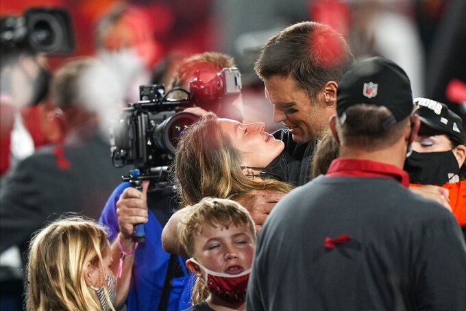 Tampa Bay Buccaneers quarterback Tom Brady celebrates with his wife Gisele Bundchen and children after the NFL Super Bowl 55 football game against the Kansas City Chiefs, Sunday, Feb. 7, 2021, in Tampa, Fla. The Buccaneers defeated the Chiefs 31-9 to win the Super Bowl. (AP Photo/David J. Phillip)