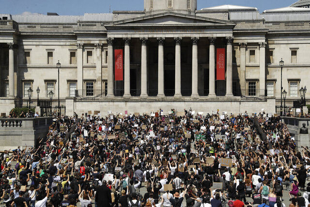 People, some of them kneeling gather in Trafalgar Square in central London on Sunday, May 31, 2020 to protest against the recent killing of George Floyd by police officers in Minneapolis that has led to protests across the US. (AP Photo/Matt Dunham)