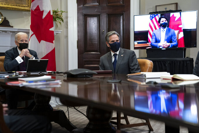 President Joe Biden and Secretary of State Antony Blinken listen as Canadian Prime Minister Justin Trudeau speaks during a virtual bilateral meeting, in the Roosevelt Room of the White House, Tuesday, Feb. 23, 2021, in Washington. (AP Photo/Evan Vucci)