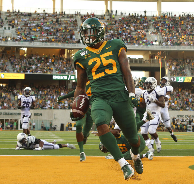 Baylor running back Trestan Ebner (25) scores past the Stephen F. Austin defense in the first half of an NCAA college football game Saturday, Aug. 31, 2019, in Waco, Texas. (Jose Yau/Waco Tribune-Herald via AP)