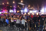 FILE - In this Thursday, June 18, 2020, file photo, patrons fill the Crow Bar in Sioux Falls, S.D. Authorities are closing honky tonks, bars and other drinking establishments in some parts of the U.S. to stem the surge of COVID-19 infections — a move backed by sound science about risk factors that go beyond wearing or not wearing masks. (Erin Bormett/The Argus Leader via AP, File)