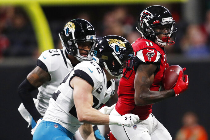 Atlanta Falcons wide receiver Julio Jones (11) makes the catch against the Jacksonville Jaguars during the first half of an NFL football game, Sunday, Dec. 22, 2019, in Atlanta. (AP Photo/John Bazemore)