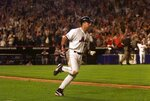 FILE- In this Sept. 21, 2001, file photo, New York Mets Mike Piazza rounds the bases on hitting a two-run home run in the eighth inning of a baseball game against the Atlanta Braves at Shea Stadium in New York. (AP Photo/Jeff Zelevansky)