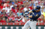 FILE - In this July 2, 2019, file photo, Milwaukee Brewers' Christian Yelich hits a solo home run off Cincinnati Reds starting pitcher Tanner Roark during the fourth inning of a baseball game in Cincinnati. Josh Bell and Yelich are among eight competitors in this year's All-Star Game Home Run Derby, which is handing out a $1 million prize to the winner. (AP Photo/Gary Landers, File)