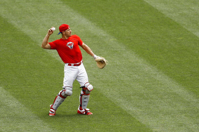 Philadelphia Phillies' J.T. Realmuto warms up in the outfield during baseball practice at Citizens Bank Park, Tuesday, July 7, 2020, in Philadelphia. (AP Photo/Matt Slocum)
