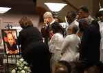 FILE - In this July 28, 2018, file photo, members of the Coleman family comfort each other at a casket during the showing for Horace Coleman, Belinda Coleman, Irvin Coleman, Angela Coleman and Maxwell Coleman in Indianapolis. Nine members of the Coleman family were killed in a duck boat accident on July 19, 2018, at Table Rock Lake near Branson Mo. A year after a duck boat sank and killed 17 people in a Missouri lake, the future of the tourist attraction remains a topic of debate. (AP Photo/Darron Cummings, File)