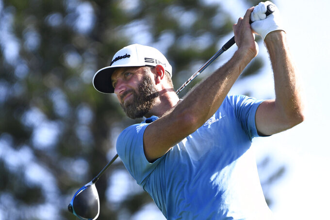 Dustin Johnson watches a shot during the second round of the Tournament of Champions golf event Friday, Jan. 8, 2021, at Kapalua Plantation Course in Kapalua, Hawaii. (Matthew Thayer/The Maui News via AP)