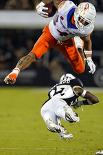 Boise State running back Cyrus Habibi-Likio leaps over Central Florida defensive back Quadric Bullard during the first half of an NCAA college football game Thursday, Sept. 2, 2021, in Orlando, Fla. (AP Photo/John Raoux)