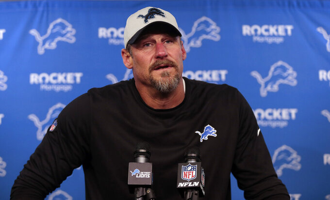 """FILE - Detroit Lions head coach Dan Campbell speaks to the media after an NFL football game against the Baltimore Ravens in Detroit, in this Sunday, Sept. 26, 2021, file photo. Campbell, Detroit's winless coach, said former NFL quarterback Drew Brees reached out to him after the Lions' latest loss last Sunday.  Campbell and Brees became close in New Orleans, where Campbell was the assistant head coach for the final five seasons of the quarterback's playing career."""" (AP Photo/Tony Ding, File)"""