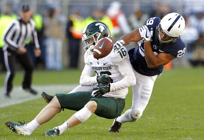 Penn State's John Reid (29) breaks up a pass intended for Michigan State's Brandon Sowards (16) during the first half of an NCAA college football game in State College, Pa., Saturday, Oct. 13, 2018. (AP Photo/Chris Knight)