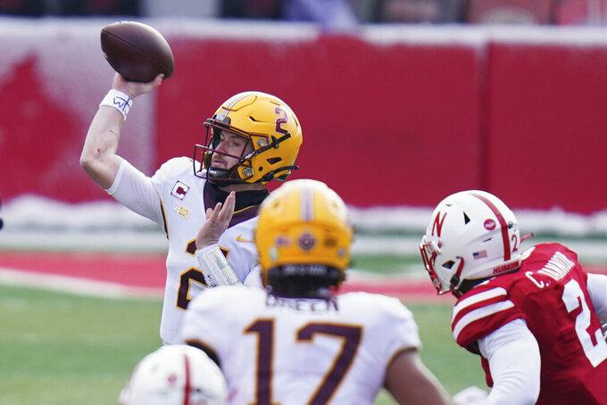 Minnesota quarterback Tanner Morgan (2) throws as pass during the first half of an NCAA college football game against Nebraska in Lincoln, Neb., Saturday, Dec. 12, 2020. (AP Photo/Nati Harnik)