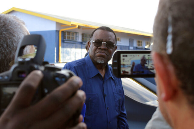In this photo taken on Wednesday, Nov. 27, 2019, Namibian President Hage Geingob arrives to cast his vote in Windhoek, Namibia. With more than 85% of votes counted, Namibia's president is set to win another term and already is thanking voters. The southern African nation's electoral commission says the president leads with 57% of the vote while the top opposition challenger has 28%. That's a sharp decrease in support for the president from 87% in the previous election in 2014. Public frustration has been high over corruption scandals and unemployment. (AP Photo/Brandon van Wyk)