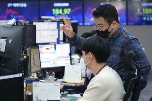 Currency traders watch monitors at the foreign exchange dealing room of the KEB Hana Bank headquarters in Seoul, South Korea, Thursday, Oct. 14, 2021. Asian shares were mostly higher on Thursday, tracking an overnight rally on Wall Street as investors sought out bargains, including technology stocks. (AP Photo/Ahn Young-joon)