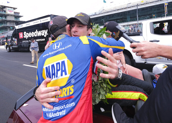 Simon Pagenaud, of France, rear, is hugged by Alexander Rossi, who finished second, after winning the Indianapolis 500 IndyCar auto race at Indianapolis Motor Speedway, Sunday, May 26, 2019, in Indianapolis. (AP Photo/AJ Mast)