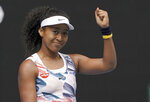 Japan's Naomi Osaka celebrates after defeating Marie Bouzkova of the Czech Republic in their first round singles match the Australian Open tennis championship in Melbourne, Australia, Monday, Jan. 20, 2020. (AP Photo/Lee Jin-man)