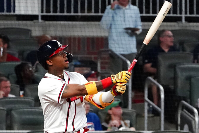 Atlanta Braves' Ronald Acuna Jr. watches his solo home run during the fifth inning of the team's baseball game against the Chicago Cubs on Tuesday, April 27, 2021, in Atlanta. (AP Photo/John Bazemore)