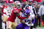Minnesota Vikings wide receiver Adam Thielen (19) is tackled by San Francisco 49ers defensive back Emmanuel Moseley (41) during the second half of an NFL divisional playoff football game, Saturday, Jan. 11, 2020, in Santa Clara, Calif. (AP Photo/Tony Avelar)
