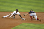 Miami Marlins Starling Marte slides safe to second base during the first inning of a baseball game against the Boston Red Sox, Thursday, Sept. 17, 2020, in Miami. (AP Photo/Gaston De Cardenas)
