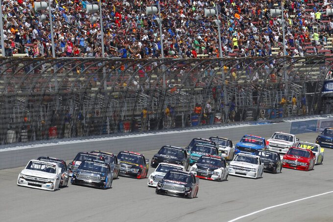 Drivers race at the start during a NASCAR Truck Series race at Michigan International Speedway in Brooklyn, Mich., Saturday, Aug. 10, 2019. (AP Photo/Paul Sancya)