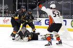 Anaheim Ducks left wing Max Comtois (53) reacts after scoring against the Vegas Golden Knights goalie Robin Lehner (90) during the first period of an NHL hockey game Thursday, Jan. 14, 2021, in Las Vegas. (AP Photo/Isaac Brekken)