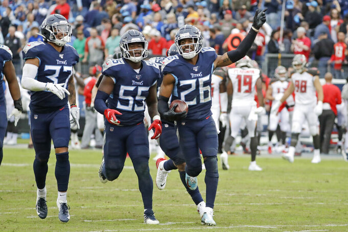 Tennessee Titans cornerback Logan Ryan (26) celebrates after intercepting a pass to stop the final drive by the Tampa Bay Buccaneers in the fourth quarter of an NFL football game Sunday, Oct. 27, 2019, in Nashville, Tenn. The Titans won 27-23. (AP Photo/James Kenney)