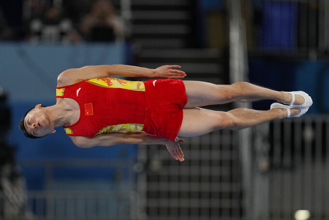 Dong Dong, of China, competes in the men's trampoline gymnastics final at the 2020 Summer Olympics, Saturday, July 31, 2021, in Tokyo. (AP Photo/Natacha Pisarenko)