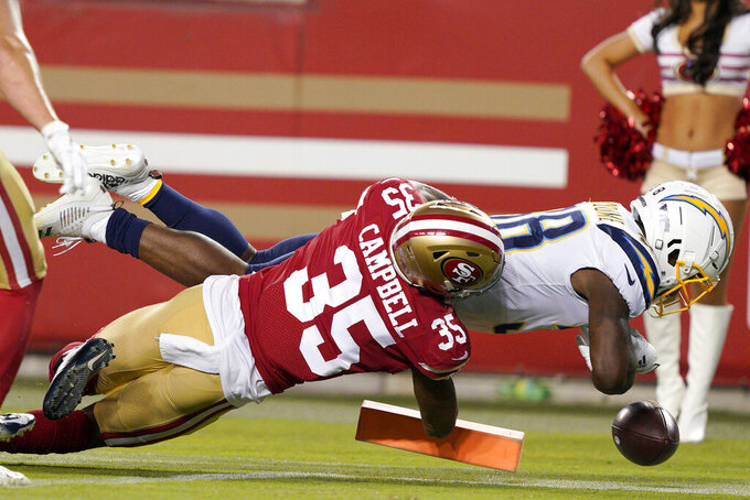 Los Angeles Chargers running back Detrez Newsome, right, is tackled by San Francisco 49ers' Chris Campbell (35) during the first half of an NFL preseason football game in Santa Clara, Calif., Thursday, Aug. 29, 2019. (AP Photo/Tony Avelar)