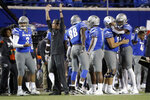 Memphis coach Mike Norvell celebrates along with players on the sideline late in the fourth quarter of the team's NCAA college football game against SMU on Saturday, Nov. 2, 2019, in Memphis, Tenn. Memphis won 54-48. (AP Photo/Mark Humphrey)