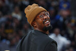 FILE - In this Feb. 26, 2019, file photo, Denver Broncos linebacker Von Miller smiles while watching an NBA basketball game between the Denver Nuggets and Oklahoma Thunder in Denver. When the coronavirus pandemic forced everyone indoors — away from their everyday environments — creativity was the key. To working. To keeping in touch. And, for those making their living playing on football fields, to thinking up ways to bond as teammates. Denver's linebackers and defensive ends were treated to some entertainment every week by star Von Miller — aka DJ Sauce Von the Don — who fully recovered after testing positive for COVID-19 in April. (AP Photo/David Zalubowski, File)