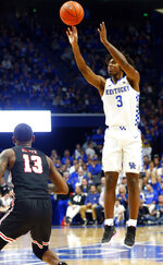 Kentucky's Tyrese Maxey (3) takes a three-point shot while defended by Lamar's Davion Buster (13) during the first half of an NCAA college basketball game in Lexington, Ky., Sunday, Nov. 24, 2019. (AP Photo/James Crisp)