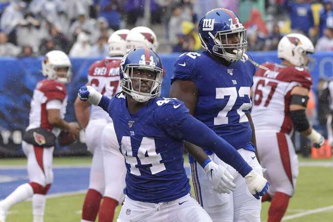 New York Giants' Markus Golden celebrates a sack during the first half of an NFL football game against the Arizona Cardinals, Sunday, Oct. 20, 2019, in East Rutherford, N.J. (AP Photo/Bill Kostroun)
