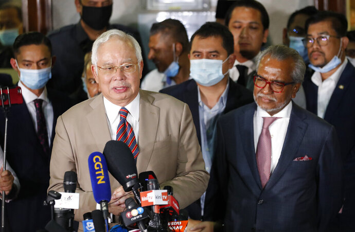 Former Malaysian Prime Minister Najib Razak speaks at the court house in Kuala Lumpur, Malaysia, Tuesday, July 28, 2020. A court has sentenced Najib to serve 12 years in prison after finding him guilty in the first of several corruption trials linked to the multibillion-dollar looting of a state investment fund that brought down his government two years ago. (AP Photo/Vincent Thian)