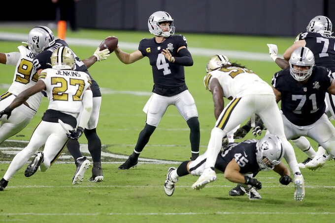Las Vegas Raiders quarterback Derek Carr (4) throws against the New Orleans Saints during the second half of an NFL football game, Monday, Sept. 21, 2020, in Las Vegas. (AP Photo/Isaac Brekken)