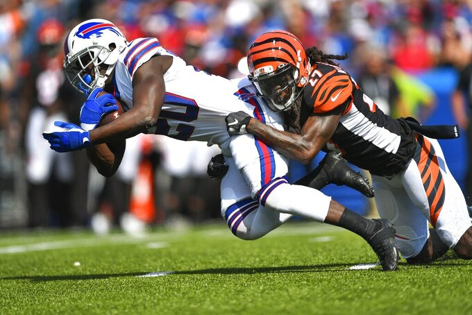 CORRECTS DATE - Cincinnati Bengals' Dre Kirkpatrick (27) tackles Buffalo Bills' Frank Gore (20) during the first half of an NFL football game Sunday, Sept. 22, 2019, in Orchard Park, N.Y. (AP Photo/Adrian Kraus)