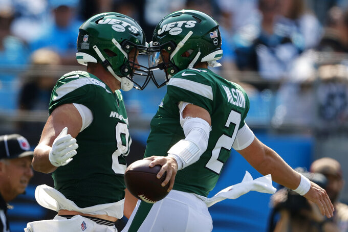 New York Jets quarterback Zach Wilson celebrates after scoring a 2-point conversion with Tyler Kroft against the Carolina Panthers during the second half of an NFL football game Sunday, Sept. 12, 2021, in Charlotte, N.C. (AP Photo/Nell Redmond)