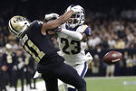 FILE - In this Jan. 20, 2019, file photo, Los Angeles Rams' Nickell Robey-Coleman breaks up a pass intended for New Orleans Saints' Tommylee Lewis during the second half of the NFL football NFC championship game in New Orleans.  The New Orleans Saints visit Los Angeles for a rematch of the NFC championship game won by the Rams, but remembered for the no-call that created the opening for Sean McVay's team to storm through. (AP Photo/Gerald Herbert, File)