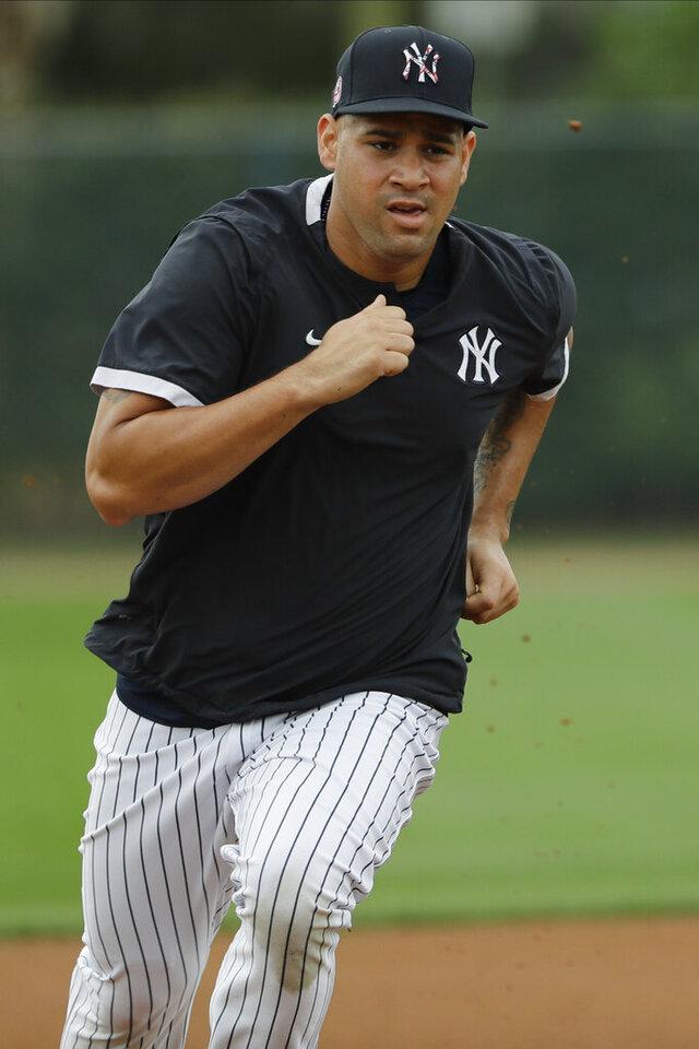 New York Yankees' Gary Sanchez runs during a spring training baseball workout Thursday, Feb. 20, 2020, in Tampa, Fla. (AP Photo/Frank Franklin II)