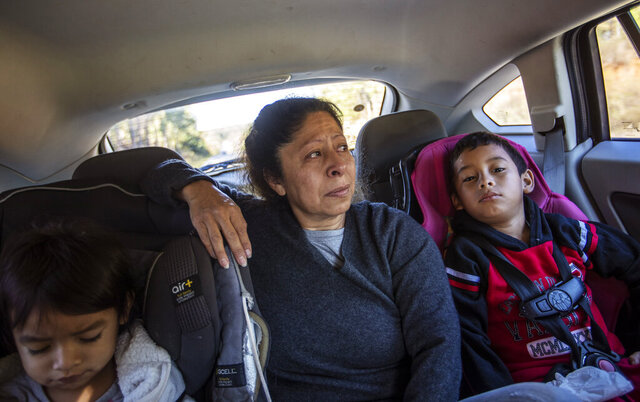 Maria Campos, 52, fights back tears while approaching the Stewart Detention Center with her grandkids to visit her son, Sunday, Nov. 10, 2019, in Lumpkin, Ga. Campos' son was deported a year ago from the same ICE facility where another son is now detained.