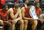 Arizona's Justin Coleman, Ryan Luther, Ira Lee and Brandon Randolph, from left, sit on the bench as the seconds tick away during the team's NCAA college basketball game against Oregon on Saturday, March 2, 2019, in Eugene, Ore. (AP Photo/Chris Pietsch)