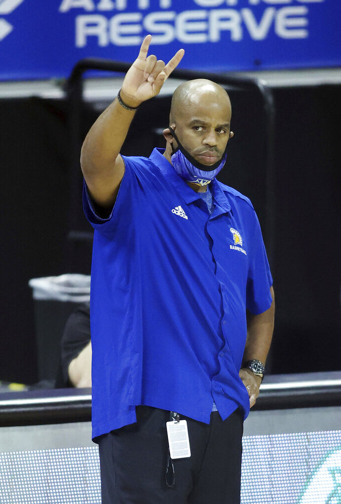 San Jose State head coach Jean Prioleau signals to his team during the second half of an NCAA college basketball game against Wyoming in the first round of the Mountain West Conference men's tournament Wednesday, March 10, 2021, in Las Vegas. (AP Photo/Isaac Brekken)