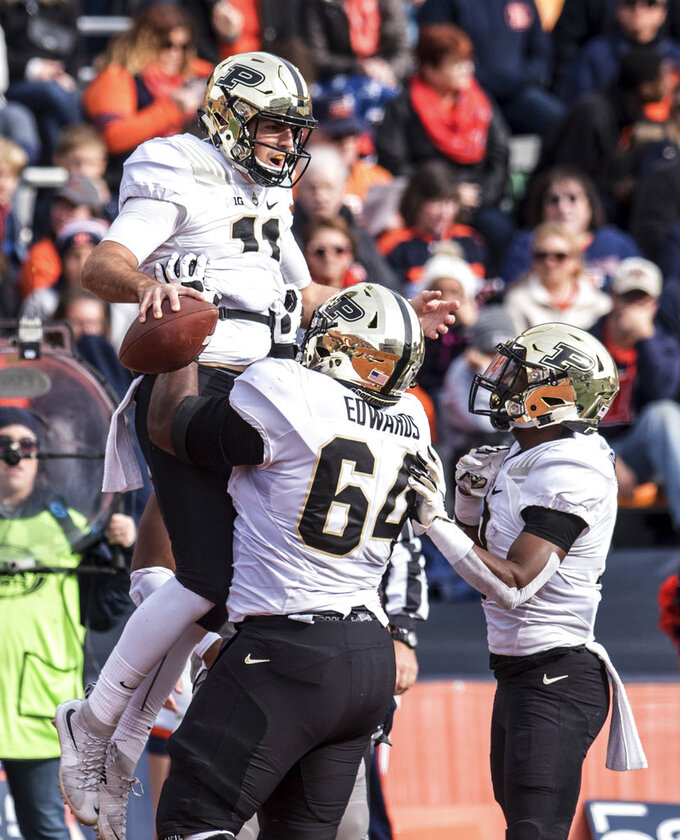 FILE - In this Saturday, Oct. 13, 2018, file photo, Purdue quarterback David Blough celebrates his touchdown catch with teammates during the first half of an NCAA college football game against Illinois in Champaign, Ill. Blough has played the finest football of his career since replacing the injured Elijah Sindelar and the defense has started coming around, too. (AP Photo/Holly Hart, File)