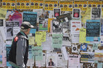 A man walks past a student activities and notices board on the University of California at Berkeley campus in Berkeley, Calif., Thursday, July 18, 2019. Soon students in Berkeley will have to pledge to