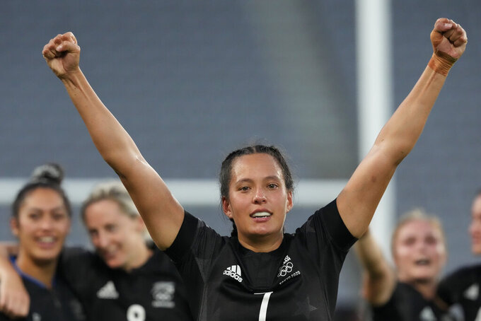 New Zealand's Tyla Nathan-Wong raises her fists as her team celebrates defeating France in the women's rugby gold medal match at the 2020 Summer Olympics, Saturday, July 31, 2021 in Tokyo, Japan. (AP Photo/Shuji Kajiyama)