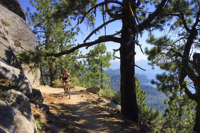A bicyclist rides down the Flume Trail near Incline Village, Nev., on July 22, 2017. Carson City sheriff's deputies are investigating the discovery of a human skull along a popular mountain biking trail at Lake Tahoe. The sheriff's office says bicyclists at Lake Tahoe State Park found the skull Sunday, Sept. 20, 2020, on the Flume Trail just north of Marlette Lake. (AP Photo/Brian Melley)
