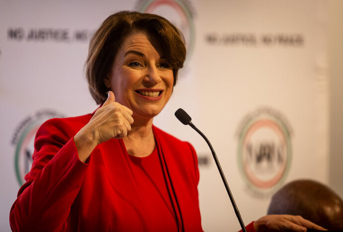 Amy Klobuchar gestures to an audience at a breakfast event on Thursday, Nov. 21, 2019, in Atlanta. Klobuchar, along with Pete Buttigieg, Cory Booker, Andrew Yang and Tom Steyer, all presidential hopefuls, spoke at the event hosted by the Al Sharpton's National Action Network. (AP Photo/ Ron Harris)